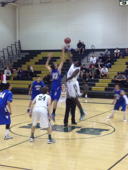 Maurice Kirby wins the opening tip of th 12/11 match between the Bears and Chandler Wolves. Chandler won, 69-62.