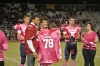 Tyrann Mathieu helps honor Breast Cancer survivors during a pre-game ceremony at John Wrenn Stadium on 10/4/13