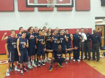 The Perry Pumas pose together after winning the Paradise Valley Invitational Tournament