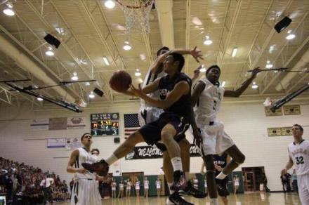 Perry's Markus Howard hits an acrobatic shot against Basha on 1/10/14 (Photo by: Dominic Cotroneo)