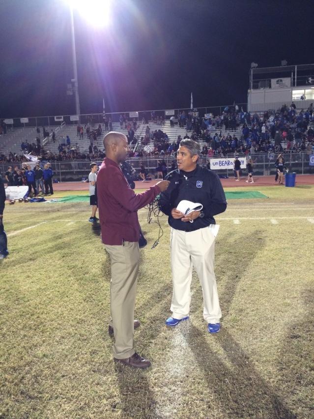 Brett Quintyne of Ctownrivals.com interviews Chandler coach Shaun Aguano (Photo by Jordan Knight)