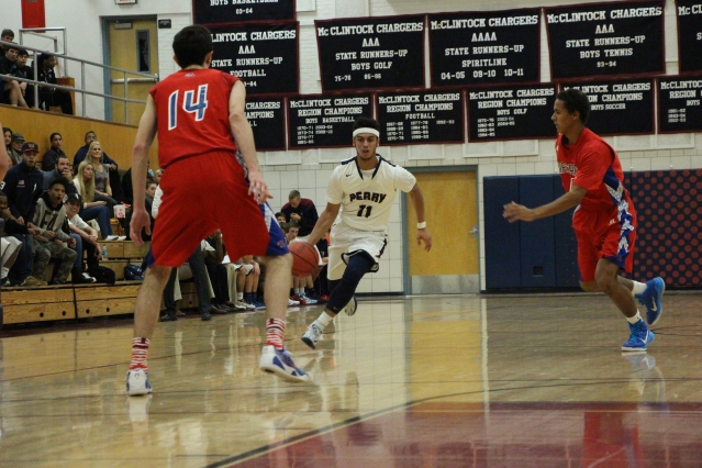 Markus Howard dribbles past Arcadia's Connor Nichols in Perry's win over Arcadia in the McClintock Holiday Shootout (Photo by Dom Cotroneo)