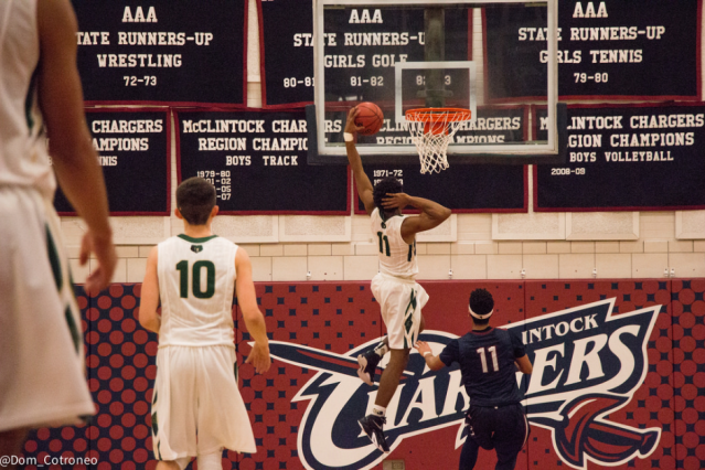 Antwan Ross-Jones dunks against Perry in the finale of the McClintock Holiday Tournament (photo by Dom Cotroneo)