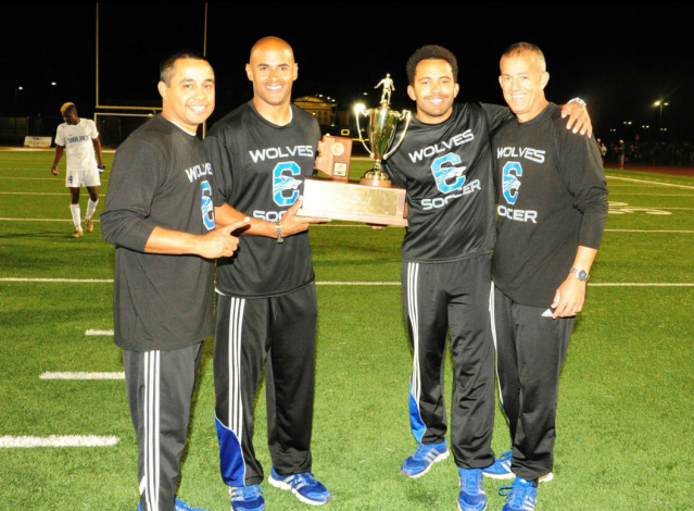 Chandler's coaching staff poses with the championship trophy (Paul Mason Photography)